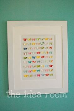 Cute idea for a girls room.  Get a white frame (or spray paint it white) then spray paint the back of the picture frame (the wood).  Use a butterfly paper punch to punch out the butterflies from scrapbook paper and glue them on with a hot glue gun.  Don't use the glass front the frame so the butterfly wings can stick out.