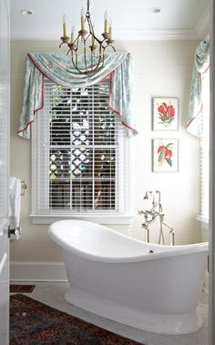 Indulgence, freestanding soaking tub  holds court in the corner of this master bathroom.