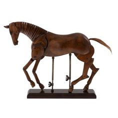 £130.00 - Artist's Wooden Horse Model. This beautiful wooden horse model is a replica of an artist's antique. When it wasn't practical to paint from life, this type of horse model would be used. The horse can be posed in a variety of positions, thanks to its fully-articulated joints and adjustable brass supports.
