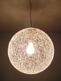 #DIY String #Chandelier  glue, string and a beach ball.   craft