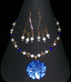 Shell and cats eye necklace and earrings.