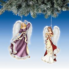 The Thomas Kinkade Heaven Sent Angels Ornaments. Set One, features Star of Wonder angel and Messenger of Peace angel. Each angel arrives holding a symbol of the blessing she bestows upon our lives. The Star of Wonder angel wears a gown accented with elegant ivory. She holds laser-cut brass stars, inviting you to reflect on the dazzling wonders of life. The Messenger of Peace angel is dressed in a gown and holds a garland of graceful doves in flight, enduring symbols of peace.