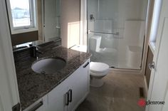 bathroom with granite countertops and backplash tile at 5625 Glide Crescent, in Harbour Landing