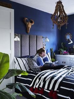 A portrait of Olivia in her bedroom.