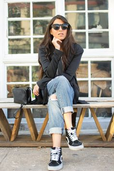 Maria Copello style and fashion blogger at Notes Of Style wears a tuxedo jacket from H&M, jeans from Madewell and Vans high top sneakers.