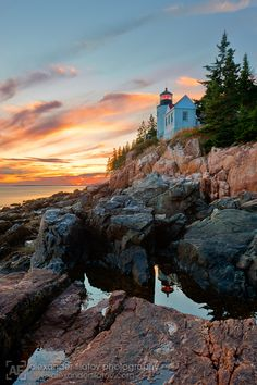 """The Bass Harbor lighthouse is located on the rocky shores of Mount Desert Island on Acadia National Park land, here captured at sunset."""
