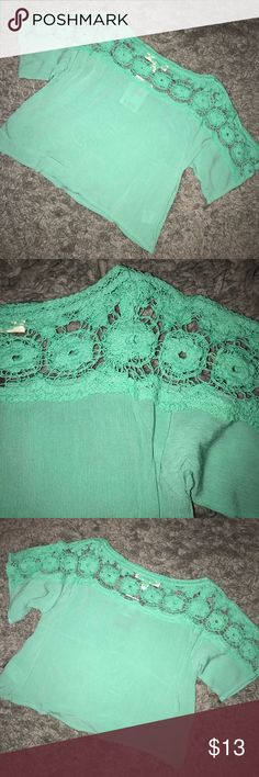 URBAN OUTFITTERS LACE SHOULDER TOP - GREEN BRAND NEW!!! With tags. A super cute and edgy girl short sleeve. Color is more of a mint green. Lace detailing lays over tops of shoulders and across top of chest. The laces is very thin crocheting. Dress it up for work, a night out, or weekend casual! Urban Outfitters Tops Blouses