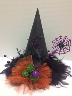 Paper mâché witch hat with feather boa, halloween picks and glitter tulle