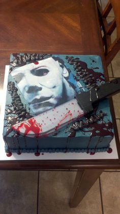 Michael Myers cake - Michael Myers is an edible image, knife is a halloween prop.