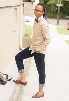 A Dapper Chick: patterned jumper over shirt with bowtie, cropped jeans, high vamp flats.
