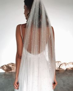 The PEARLY long veil is handmade from sheer ivory, pearl-studded tulle that we created to give the illusion of floating pearl drops that effortlessly dance over the skin. Ivory Veil, Cathedral Wedding Veils, Bride Veil, Lace Veils, Bridal Veils And Headpieces, Dream Wedding Dresses, Wedding Dress With Pearls, Wedding Dress Veil, Wedding Tiara Veil