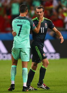#EURO2016 Gareth Bale of Wales and Cristiano Ronaldo of Portugal hug after the UEFA EURO 2016 semi final match between Portugal and Wales at Stade des Lumieres...