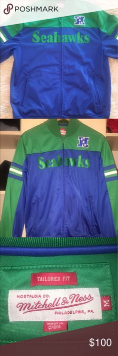 Authentic Mitchell & Ness Tailored Fit Sweater Size: Medium. This blue, green and white Seattle Seahawks NFC championship zip up sweatshirt has only been worn once and never again after that! No damage or stains! Originally purchased for $150, open to all offers! Mitchell & Ness Jackets & Coats Bomber & Varsity