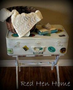 Old suitcase, paint and some cool stickers and you have great storage.  Love this look