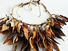 Autumn leaves leather necklace with glass beads. van Vittro op Etsy, $70.00