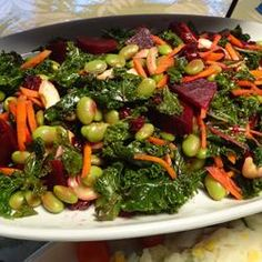 Super Summer Kale Salad - a friend made this salad for us and i downed about 3/4 of it in one sitting and now i can't stop thinking about it. it didn't have edamame or blueberries but was wonderful. seems to have a lot of variation options, too. yummmmm