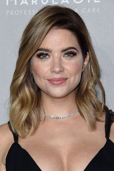 The Pretty Little Liars star kept her roots dark on her blonde lob, which means less maintenance as her hair grows out into a classic ombré look.