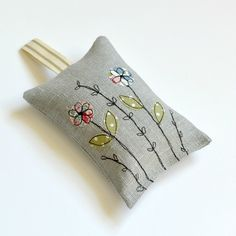 Handmade grey linen lavender bag, Lavender sachet, Scented bag filled with dried English lavender. A lovely handmade linen Lavender bag, lavender sachets filled full of lovely smelling dried English lavender. Decorated with an embroidered wild flower d. Embroidery Bags, Free Motion Embroidery, Embroidery Designs, Lavender Bags, Lavender Sachets, Lavander, Freehand Machine Embroidery, Free Machine Embroidery, Embroidered Gifts