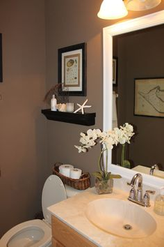 Nice bathroom colors and decor from Starfish Cottage.
