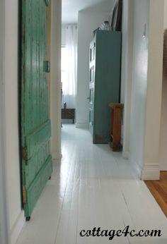Rehab damaged wood floors with fresh white paint.