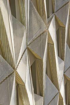 Brenac & Gonzalez wraps a workplace with golden origami-like skin - News - Frameweb
