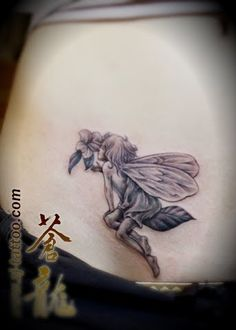 fairy tattoo. maybe with a clover instead of a flower.