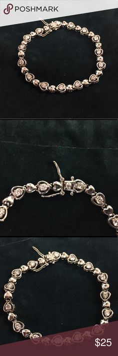"""Heart Shaped Tennis Bracelet 💙Gorgeous alternating silver and crystal (CZ) hearts. Sterling silver. Double safety latch closure. Approximately 7 1/2"""" in length. In excellent condition. Jewelry Bracelets"""