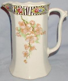 TALL CERAMIC PITCHER WITH FLORAL DECORATION. 1945