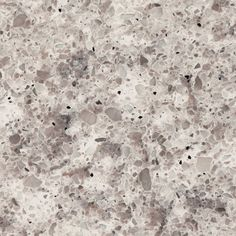 6270 Atlantic Salt™ by Caesarstone - It's intricate, sculpted design and combination of white, taupe grey and black colors echo the natural structure of inspiring aged granites weathered by the ocean. The white accents work with clean minimal interiors as well as more traditional.