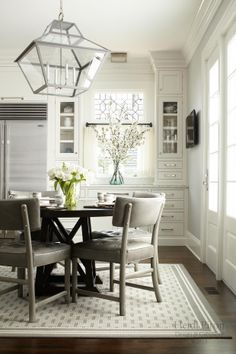 Gray is a great neutral to add for a touch of color to the classic white kitchen. (Cultivate.com)