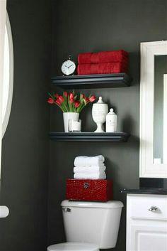 Floating shelves above toilet