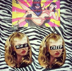 Beat it, creep. Earrings