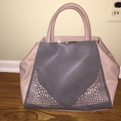 Danielle Nicole Handbag Never been used, great condition. Comes with shoulder strap. Danielle Nicole Bags Satchels