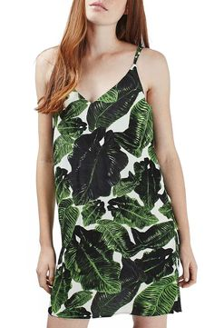 Bringing the tropics everywhere in this lightweight slipdress with a crisscross back.