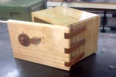 Mark Ramsay's combination lock Thought I'd drop a line on my new project. I've incorporated your lock into a wooden box and made a 'Safe'. I used 100+ year old Silky Oak for the lock spools, tongue, rails, lock lever, dial and hinges. The box body is laminated ply and a nice piece of pine for the door. The dowels are Tasmanian oak. Anyway, here are some pics.