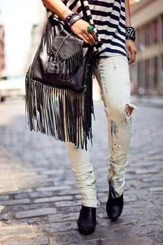 bleached denim , black and white striped , fringed black leather bag