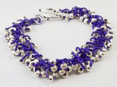 "Shaggy Chain Maille Bracelet Fun, light, feel good!! Shake your wrist...  The movement of the beads and rings just feel good without a lot of jingle!   They can be dressed up or down. Look fabulous stacked.  They always get compliments.     Bright purple rings and silver toned sead beads!  The bracelet is 7.5"" - would happy to make it smaller or larger - convo me.  Can turn it over in one day."
