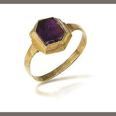 A 13th/14th century ring  The hexagonal slice of amethyst in a closed-back gold setting, ring size approximately P½  Estimate: gbp2,000 - 3,000  US$ 3,200 - 4,800  €2,500 - 3,800  Footnotes  Found in North Yorkshire, treasure number 2010T674. The Crown's interest in this ring has been disclaimed.