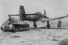 Panzer I Ausf. A towing a Junkers Ju 87 Stuka dive-bomber. Luftwaffe, Panzer Ii, Ww2 Aircraft, Military Aircraft, German Soldier, Afrika Korps, Ww2 Planes, North Africa, War Machine
