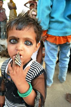 My first submission Reddit, I hope you like it! I met this young girl in a village in Northern India. Her mother told me the kohl on her eyes is used to protect her from demons.