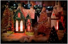 Bottle brush trees and mache houses. Very evocative of grand moms treasures..