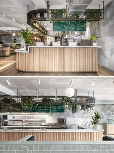 This modern restaurant features a service area with a wood facade, a white countertop, and rendered concrete walls. #RestaurantDesign #RestaurantInterior
