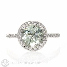 So pretty and feminine, the palest of pastel Green Amethyst is surrounded by a halo of diamonds! This ring is available in 14K White, Yellow or Rose