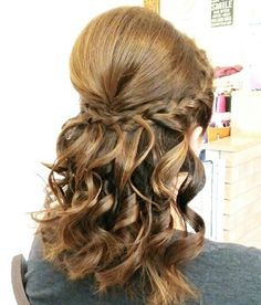 Curly hairstyle with side braids!