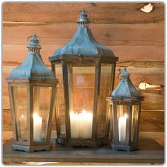 Let's put a trio of these lanterns at each corner of the bar / tuck greenery and gold and orange florals (per your palette) around base