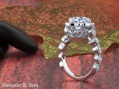 Vintage style engagement ring with ornate gallery.