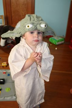 Yoda Hat Crochet pattern plus this picture is super adorkable. The geek in me wants my kids to be this cool.