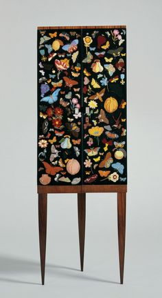 Corner Cabinet with Reverse-Painted Glass Doors, Gio Ponti (1891-1979) and Piero Fornasetti (1913-1988) Italy, probably Milan, 1941.(via Home Decor and Furniture)