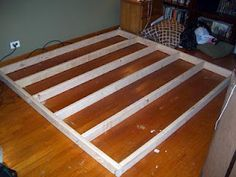 """$30 DIY King Platform bed=8 – 2 x 4 x 8; cut down to 2 x 4 x 76"""" (don't cut any of these until you read the entire tutorial).  SAVE THE SCRAPS--YOU WILL NEED THEM FOR LEGS!  8 - 20"""" scraps from above beams, cut 2"""" off of one end of two boards (leaving you with 6@ 20"""" and 2@ 18"""")  2 – ½"""" x 4' x  8' Sheets of Plywood, cut to 38"""" x 80"""" (don't cut these until you read the entire tutorial"""