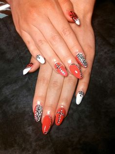Stiletto nails with zig zag hand painted nail art & bling